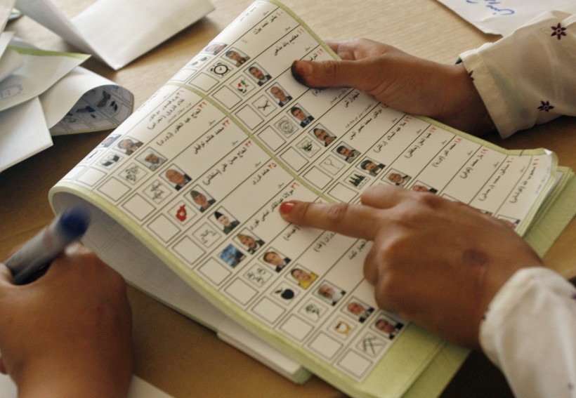 An election official sorts the ballot paper at the polling station in the southern Afghan city of Kandahar