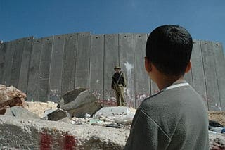 320px-Boy_and_soldier_in_front_of_Israeli_wall