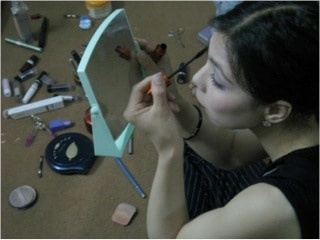 Massoma applying make-up. Women's National Dormitory, Kabul. 2007 © Julie Billaud