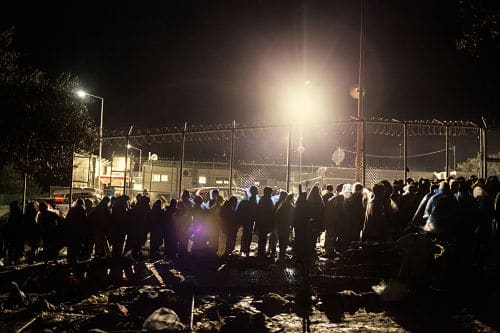 Lesvos. Greece. Oct. 25, 2015. The line to enter the Moria registration centre during a storm.