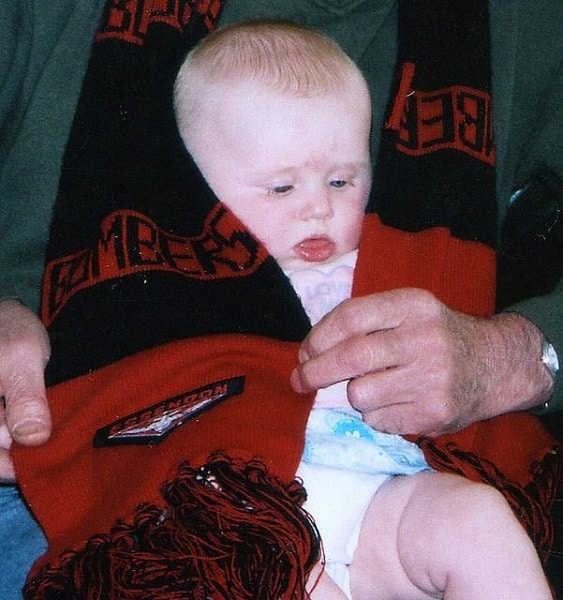The Footy Scarf (Bombers): Draped around the toddler by her Australian grandfather. She later chose her grandmother's team instead!